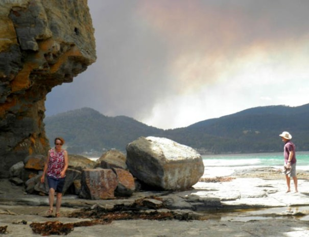 Photo: Louise Cunningham – cliffs along centre of Pirates Bay. (Note the approaching bushfire - Jan 2013)